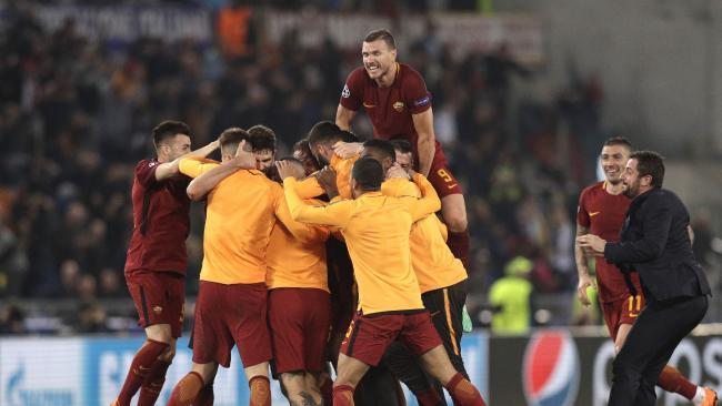 Roma player celebrate