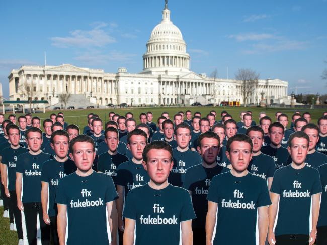 One hundred cardboard cutouts of Facebook founder and CEO Mark Zuckerberg stand outside the US Capitol in Washington, DC to raise awareness of fake accounts spreading disinformation on Facebook. Picture:  AFP