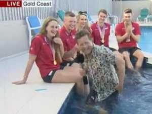 Reporter falls in pool on live TV