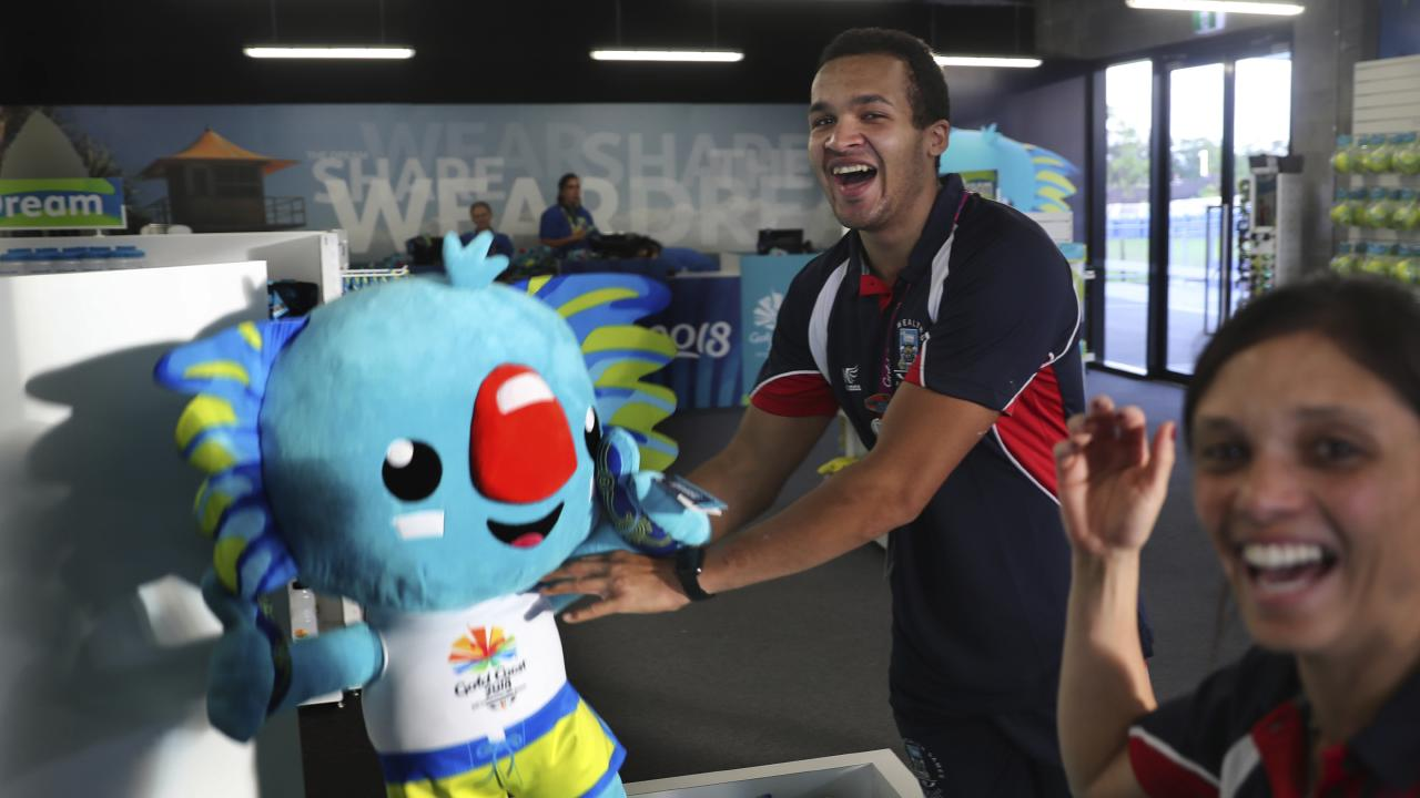 Athletes from the Falkland Islands play with popular Commonwealth Games mascot Borobi at the Games village. (AP Photo/Manish Swarup)