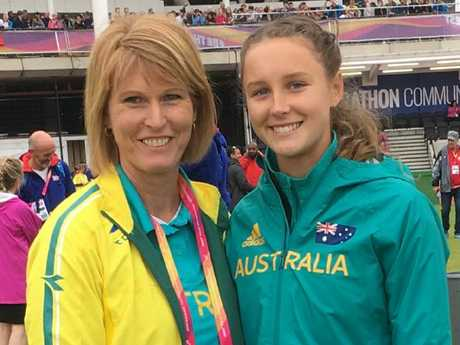 Riley Day (right) with coach Donna Thomas at last year's world championships.
