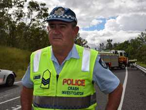 Crash investigator stands with MP on Bruce Highway upgrade