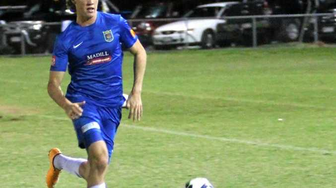 ON THE BALL: Chris Jancevski Noosa's left back on a trade mark run from defence.