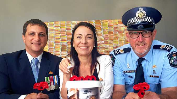 Nigel Cuppari, Tracey Caruana and Senior Sergeant Office In Charge Geoffrey Noller with ANZAC pins currently for sale.