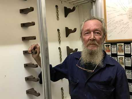 Gympie museum's Allan Blackman with the display cabinet that was broken into on Tuesday.