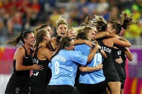 New Zealand celebrate after Grace O'Hanlon's semi final heroics.