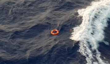 A life buoy floats in the sea as the search goes on.