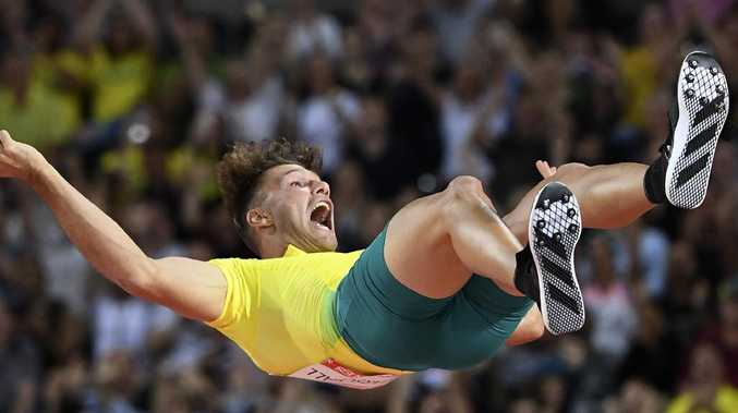 Kurtis Marschall of Australia celebrates as he falls to the mat after clearing 5m during the Men's Pole Vault Final on Thursday night.