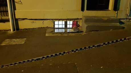Police photograph the scene where a baby was found on a footpath in Surry Hills.