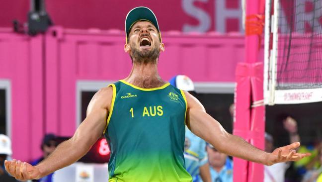 Christopher McHugh of Australia reacts after winning beach volleyball gold.