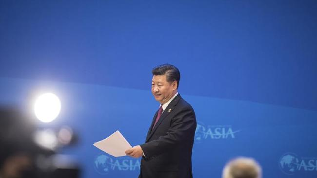 Xi Jinping, China's president, prepares to walk off stage after speaking at the Boao Forum for Asia. Picture: Qilai Shen/Bloomberg