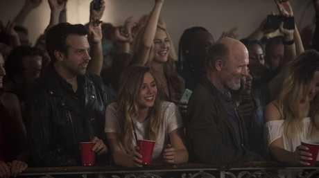Jason Sudeikis, Elizabeth Olsen and Ed Harris in a scene from the film Kodachrome.