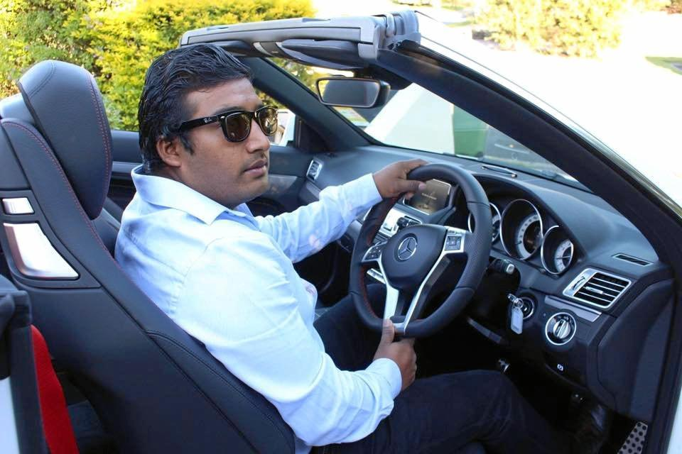 Hom Pyashi with one of his two Mercedes Benz cars.
