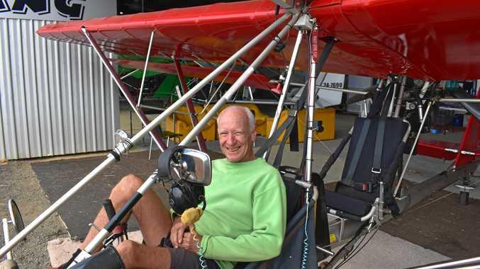 EXPERIENCED FLYER: John Blain in a tug plane at the Dalby Aerodrome.