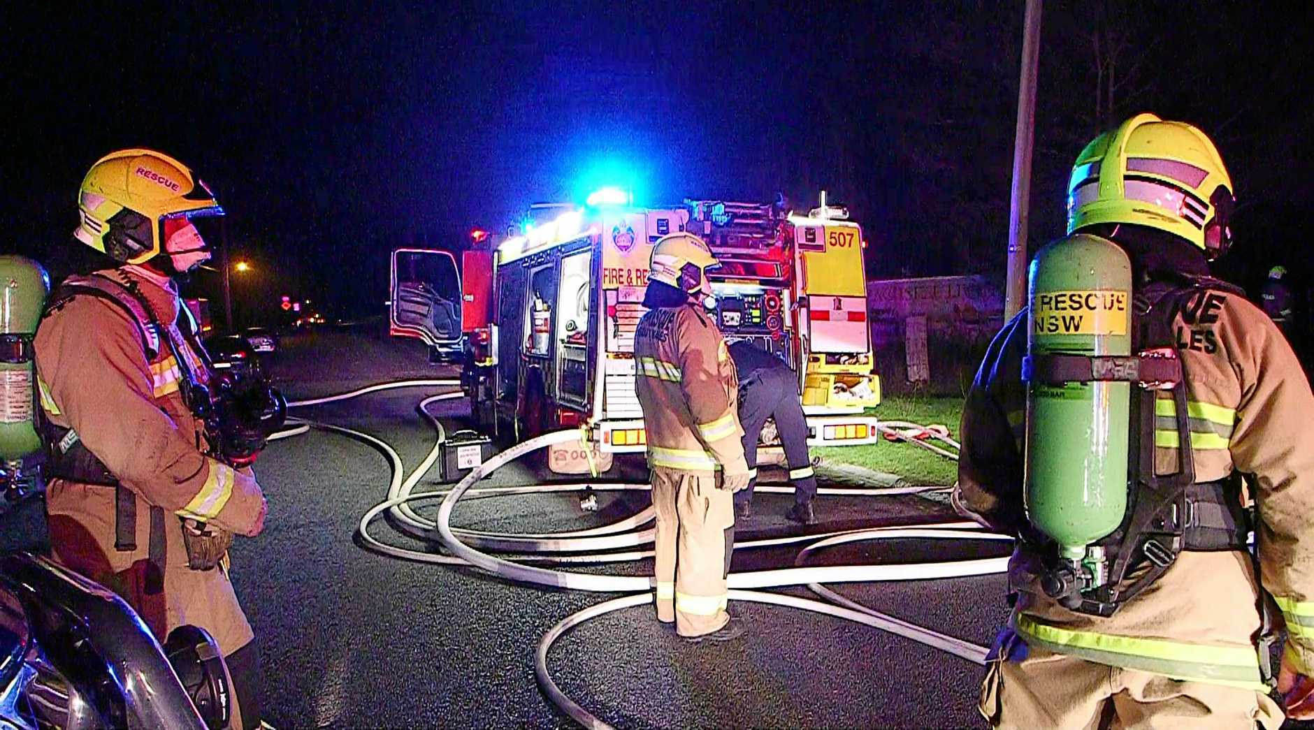 Fire and Rescue NSW crews respond to a house fire on Thursday night.