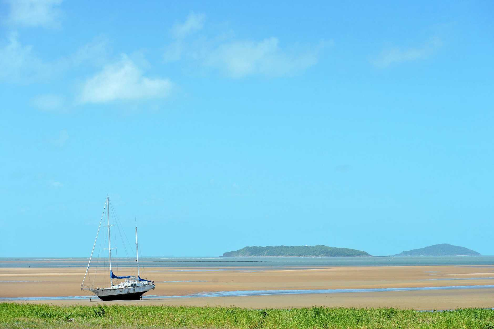 Yacht beached on a Sandbar along Town Beach, Mackay