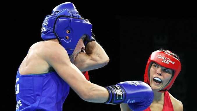 Taylah Robertson, of Australia, (red) and Lisa Whiteside, of England, (Blue) compete in their Women's Fly 48-51kg Semifinal bout. Photo: Mark Metcalfe/Getty Images.