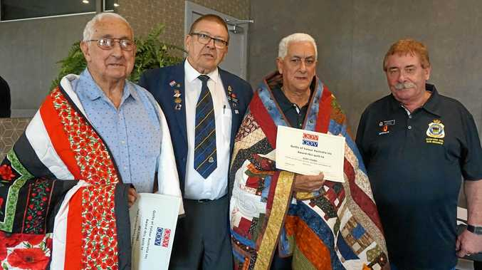 QUILTS OF VALOUR: Brothers Reg and Gary Young were honoured by the presentation of Quilts of Valour, thanking them for their service, sacrifice and valour in the Second World War and Vietnam, respectively. They are with Quilts of Valour Australia's Stan Allen and Gosford RSL sub-branch president Greg Mawson.