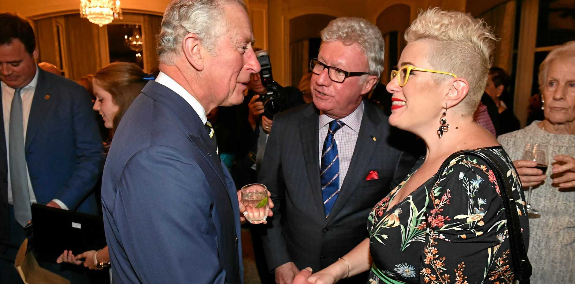 WOW FACTOR: Britain's Prince Charles meets with Australian Singer Katie Noonan at a reception at Queensland Government House in Brisbane.