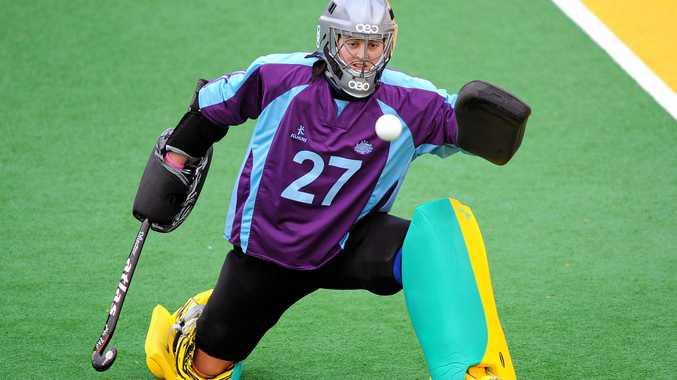 Hockeyroos goalkeeper Rachael Lynch blocks a shot during a practice session.