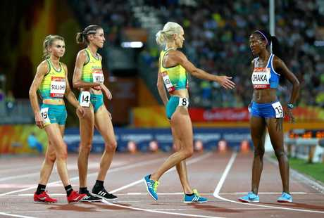 GOLD COAST, AUSTRALIA - APRIL 09:  Lineo Chaka of Lesotho is greeted by Eloise Wellings of Australia, Madeline Hills of Australia and Celia Sullohern of Australia as she finishes the Women's 10,000 metres final during the Athletics on day five of the Gold Coast 2018 Commonwealth Games at Carrara Stadium on April 9, 2018 on the Gold Coast, Australia.  (Photo by Michael Steele/Getty Images)