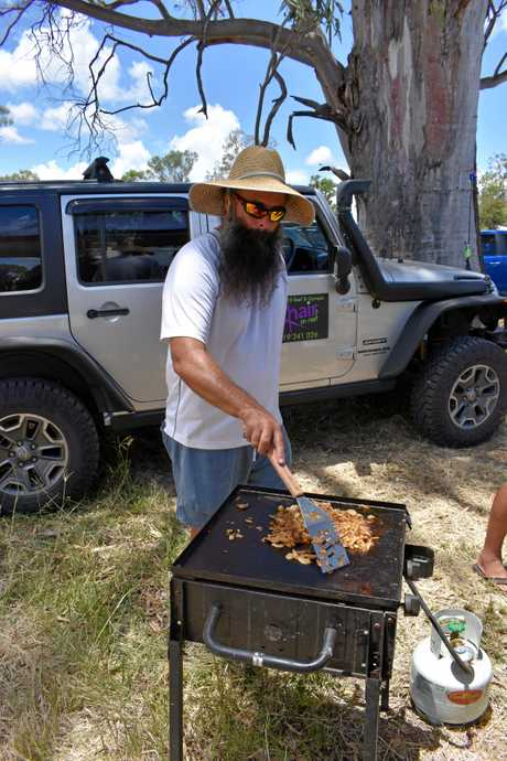 Cooloola 4WD club member Luke Mancell in charge of the onions for a fundraising sausage sizzle.