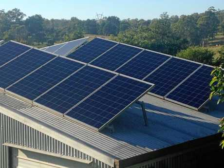 REAPING THE REWARDS: Solar panels soaking up the rays at Rod Smith's Gympie home.