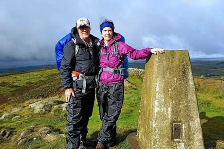 Garry Williamson and Rowena Robertson at the highest point of Hadrian's Wall on wild and windy Winshields Crag.