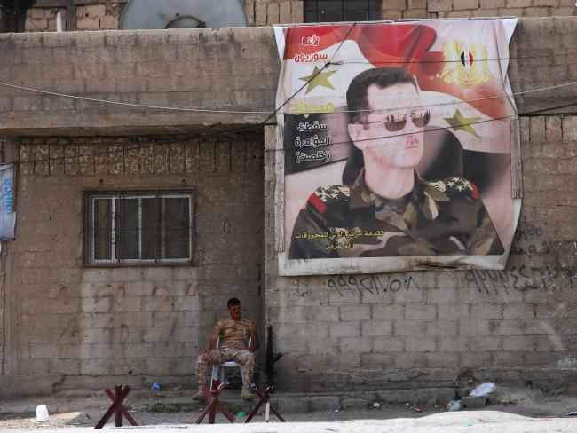An attack on Syrian president Bashar al-Assad could spark an international conflict, with Russian and Iranian forces supporting the regime. Picture: AFP Photo/Youssef Karwashan
