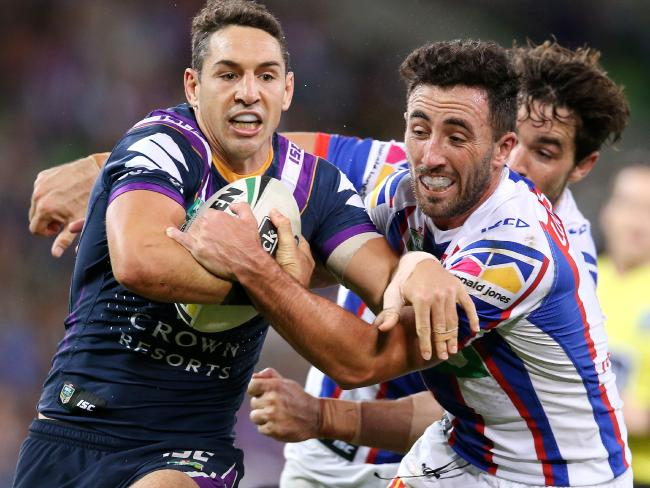 Billy Slater tries to charge through the Knights. Pic: Michael Klein