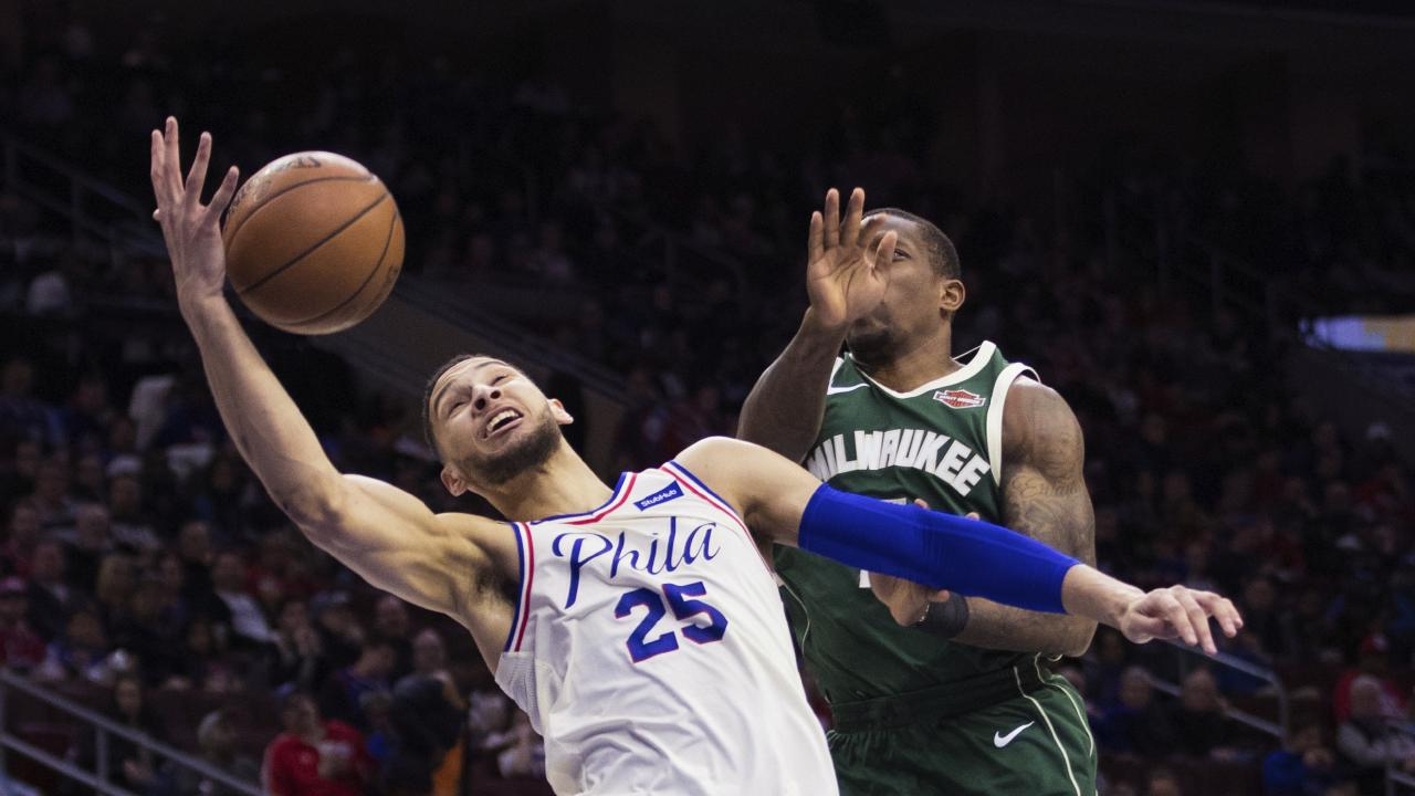 Philadelphia 76ers' Ben Simmons goes for the ball as Milwaukee Bucks' Eric Bledsoe defends.