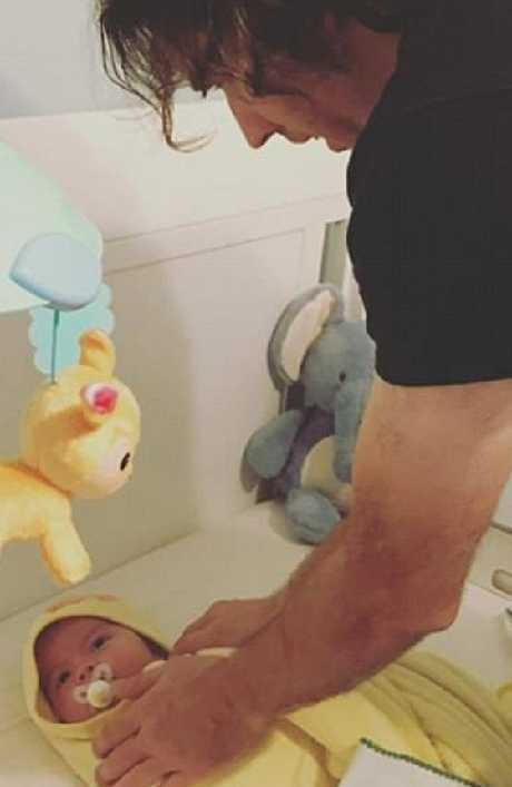 Steven Pladl dries Bennett, his son with biological daughter Katie, after bathing him. Picture: Instagram