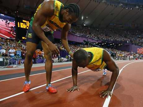 Yohan Blake watches on as Usain Bolt does push ups to celebrate winning the men's 200m final at the London 2012 Olympic Games. Pic: EPA/KERIM OKTEN.
