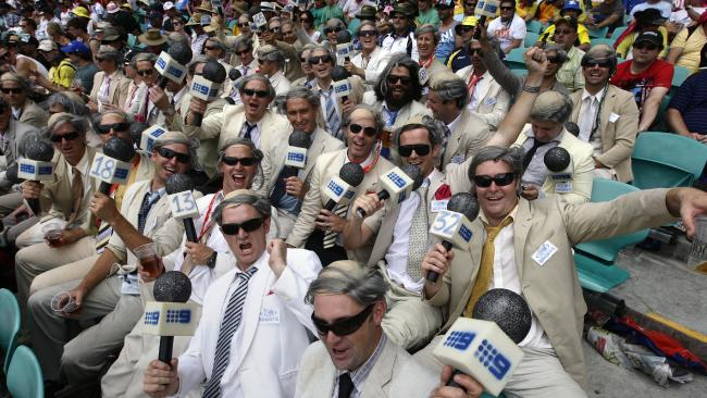 Three rows of group known as the Ritchie crew, fans of Channel Nine commentator Benaud in the stands at the SCG in Sydney for second Test match of Australia v India series.