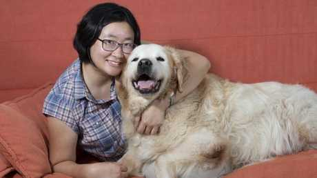 Dr Cindy Tan with her 14-year-old golden retriever, Archie. Picture: Renae Droop