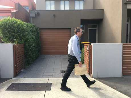 Forensic detectives leave Sarah Gatt's home.