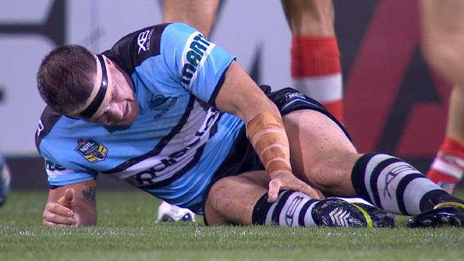 Paul Gallen clutches his injured knee.