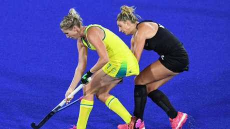 Jodie Kenny of Australia goes up against Olivia Merry of New Zealand.