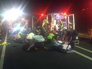 Man still critical after struck on Warrego Highway