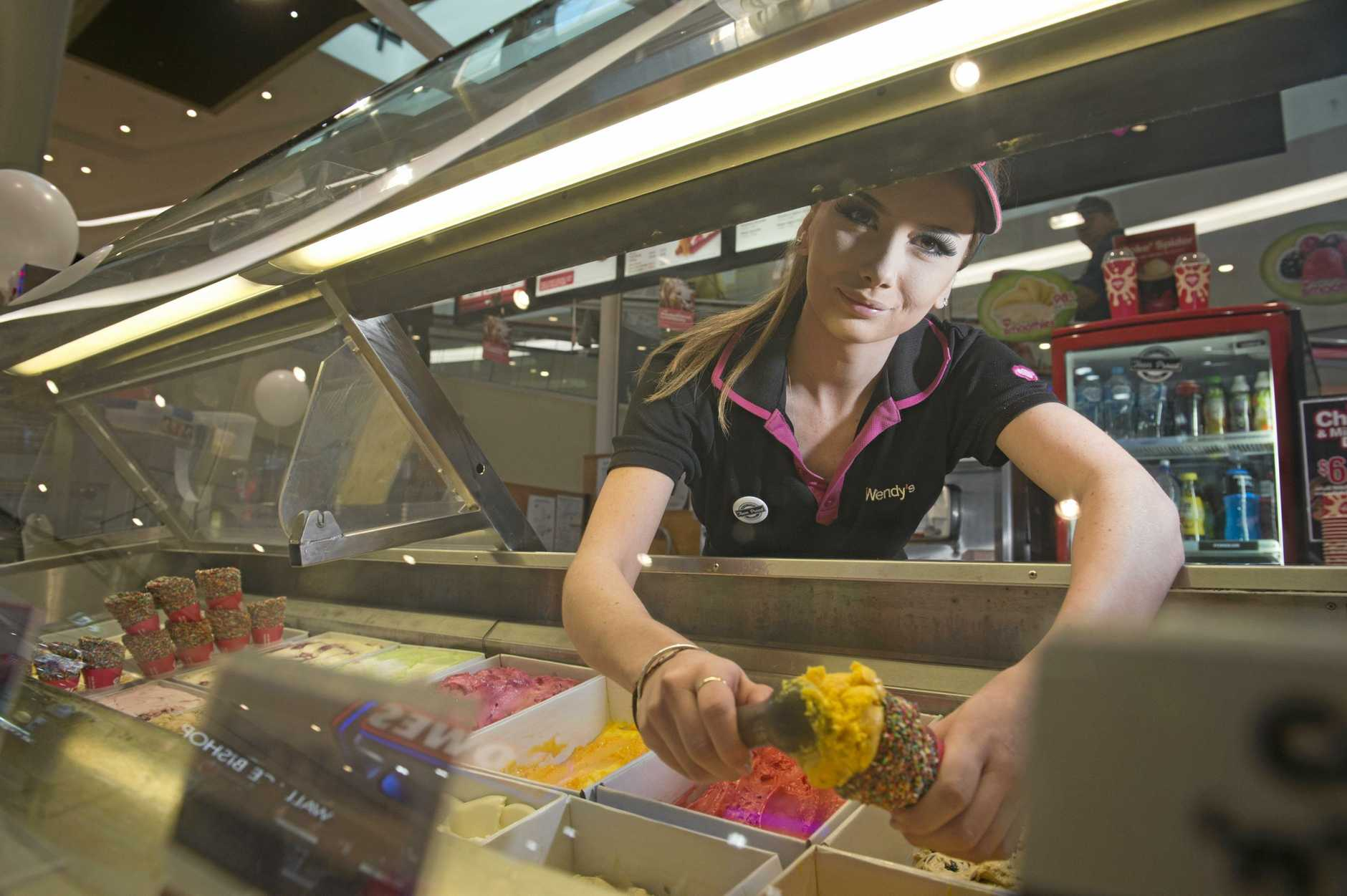 File image of a Wendy's franchisee shop assistant scooping up ice cream a few years ago.