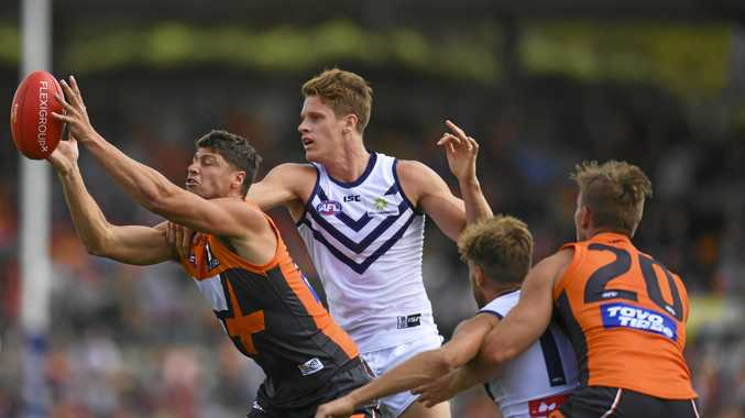 Jonathan Patton of the Giants marks strongly against the Dockers at s UNSW Canberra Oval on Saturday.