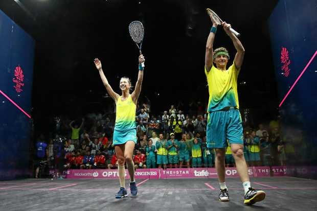 Australia's Donna Urquhart and Cameron Pilley celebrate their mixed doubles gold medal.