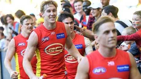 Tom Lynch celebrates Gold Coast's win over Carlton.