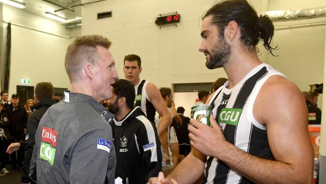 Collingwood Coach Nathan Buckley congratulates Brodie Grundy on a job well done.