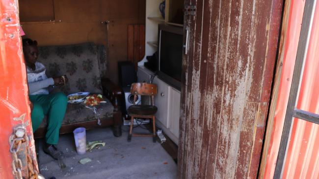 This Langa shack is home to an entire family but is so small that the lounge triples as a seat, bed and kitchen. Picture: Megan Palin.