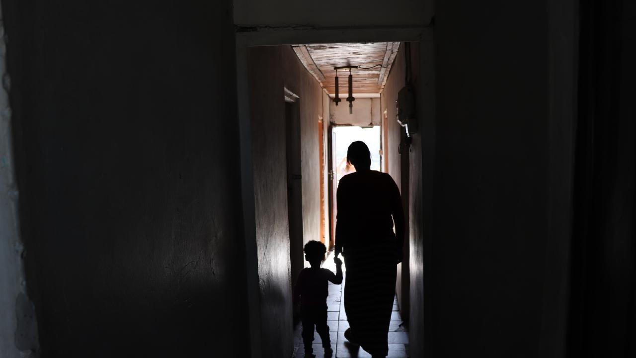Jaydene's Preschool principal Landi Jacobs shows news.com.au inside her mother's Knysna township home, South Africa.