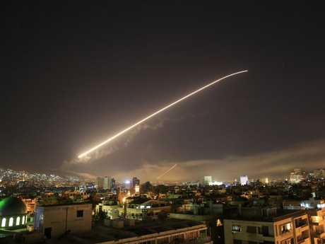 Damascus sky lights up as the U.S. launches an attack on Syria in retaliation for the country's alleged use of chemical weapons. Picture: AP Photo/Hassan Ammar