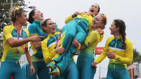 Australia's Chloe Hosking celebrates with team mates after winning Gold during the Road Race on day 10 of the Gold Coast 2018 Commonwealth Games.