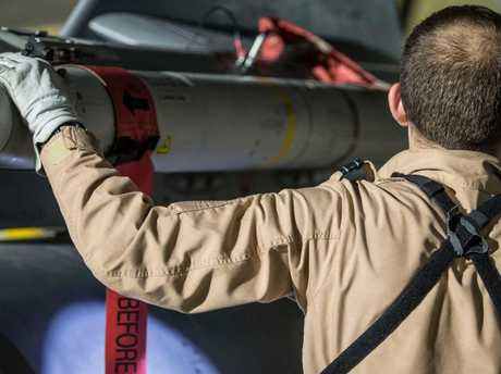 A Tornado pilot checks the weapons on his Tornado at Britain Royal Air Force base in Akrotiri, Cyprus, after its mission to conduct strikes in Syria to punish President Bashar Assad for an apparent chemical attack against civilians. Picture: Cpl L Matthews/MoD via AP