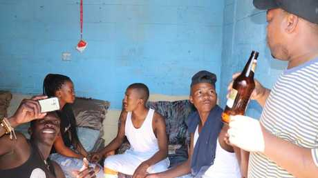 A group of friends enjoys a Sunday session in Langa, South Africa. Picture: Megan Palin.